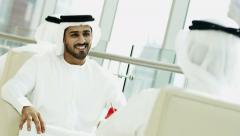 Arabic male business colleagues Gulf Region UAE city insurance economy export Stock Footage