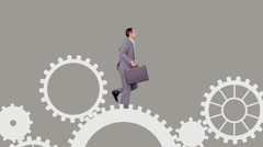 Business people running and turning cogs Stock Footage