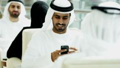 Dubai Arab business male mini tablet technology commercial economy marketing - stock footage