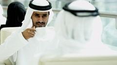 male Emirati clothing hotel atrium coffee relaxation travel tourism - stock footage