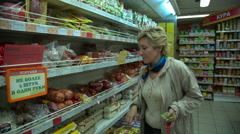 Woman shopping in the supermarket - stock footage
