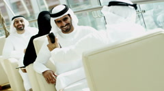 Arab male kandura tablet social leisure UAE hotel culture lifestyle traveller - stock footage