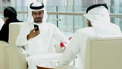 business male kandura Dubai financial real estate mini tablet device - stock footage