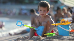 Cute little child playing on the beach, summertime - stock footage