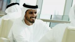 Emirati male business meeting oil commodity financial mini tablet technology - stock footage