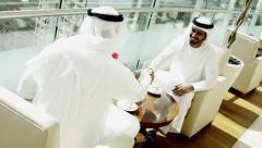 Arab male kandura leisure Arabia hotel visitor travel friendship handshake - stock footage