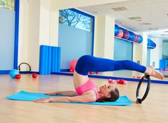 Pilates woman roll over magic ring exercise Stock Photos