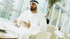 Arab male kandura leisure Arabia hotel visitor traveller friendship handshake - stock footage