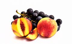 Tasty Peaches and Grapes. Fruity Nectarines and Grapes - stock photo