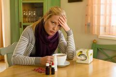 Woman has a cold. flu season Stock Photos