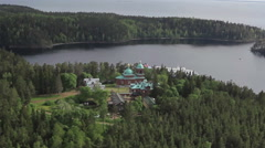 RUSSIA. Valaam - 2014: Aerial view of the Church in the forest Stock Footage