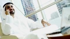 Emirati business man Dubai financial insurance growth economy laptop smart phone - stock footage