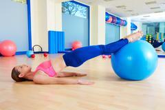 Pilates woman pelvic lift fitball exercise workout - stock photo