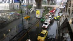 Traffic congestion at one lane, bus try to change lane, rainy weather Stock Footage