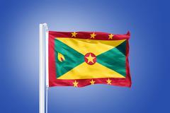 Flag of Grenada flying against a blue sky Stock Photos
