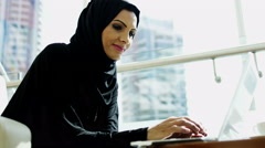 Arab businesswoman traveller abaya oil city wireless laptop computer smart phone Stock Footage