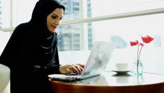 Emirati business woman Dubai financial insurance economy laptop smart phone Stock Footage