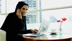 economy oil developer female Arab business abaya laptop smart phone technology - stock footage