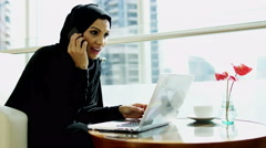Arabic business female stocks shares commodity laptop computer smart phone - stock footage