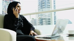 Arabic female construction real estate business laptop smart phone technology - stock footage