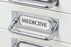 A drawer cabinet with the label Medicine - stock photo