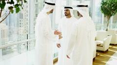 Arab males kandura social leisure UAE hotel traveller lifestyle visitor tourism - stock footage