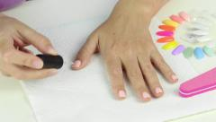 Manicure in process - painting gel polish Stock Footage
