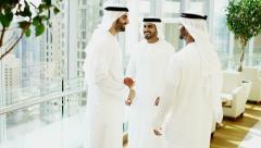 business male handshake national dress Dubai real estate insurance planning - stock footage