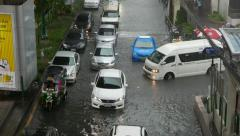 Minivan turn to flooded street, traffic jam at rainfall Stock Footage