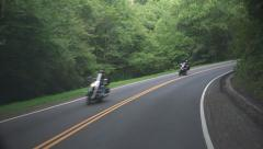Motorcycles Riding Through the Mountains Stock Footage