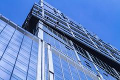 Modern office building. Window washers on skyscraper. - stock photo