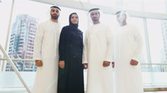 portrait UAE business male female city office kandura abaya stocks shares broker - stock footage