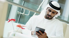 male Arab real estate business executive national dress office tablet technology - stock footage