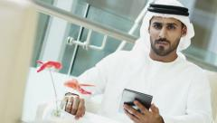 portrait man Arab kandura beard business meeting traveller city economy tablet - stock footage
