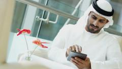 Arabic male Emirates stocks shares commodity marketing technology mini tablet - stock footage
