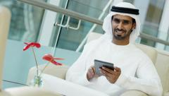 portrait Arabic male Emirates stocks shares commodity technology mini tablet - stock footage