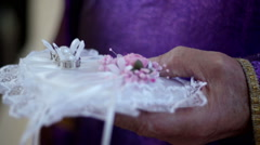 Wedding rings on cushion Stock Footage