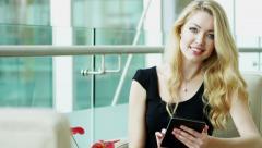 portrait Eastern European business female tablet technology stocks shares market - stock footage