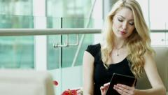 Eastern European business female tablet technology trading stocks shares markets Stock Footage