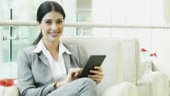 portrait female Western Caucasian business finance traveller technology tablet - stock footage