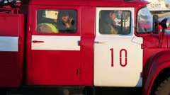 Firefighters in a fire engine. Close-up Stock Footage