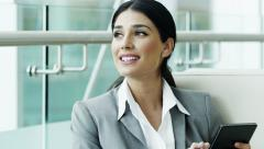 Spanish business female tablet technology trading stocks shares broker markets Stock Footage