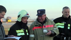 Rescuers talking and laughing Stock Footage