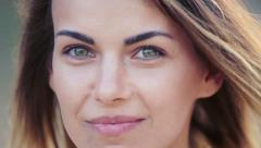 Pretty girl looking  of the camera. Portrait of a pretty girl close-up. - stock footage