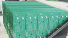 A row of SMT circuit boards, focus spool Stock Footage