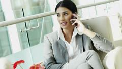 Western Caucasian woman business insurance touch screen smart phone technology - stock footage