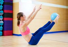 Stock Photo of Pilates woman stability ball teaser exercise