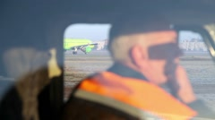 Airport worker. The aircraft in the background Stock Footage