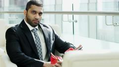 portrait male Middle Eastern business traveller finance technology tablet - stock footage