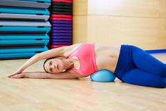 Pilates woman stability ball exercise gym workout - stock photo